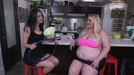 Fat blonde gets funnel fed by skinny brunette